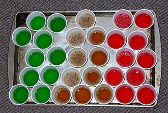 Gelatin dessert - A tray of gelatin shots prior to refrigeration