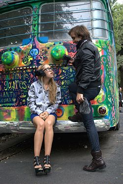 Model and photographer in front of a trolleybus in Colonia Hipodromo painted by Fumiko Nakashima. The Roma-Condesa neighborhoods of Mexico City are known for their hipster subculture.[1]