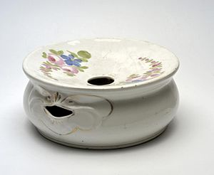 Spittoon - Decorated Surinam porcelain spittoon. Note this type of spittoon has a spout hole on the side for emptying.