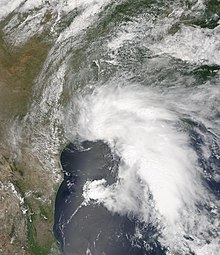 Satellite imagery of a large, disorganized tropical storm near peak intensity