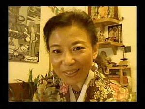 Woeser - Woeser in her Beijing apartment in 2009 in front of her Tibetan Buddhist altar