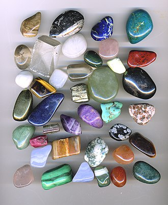 Tumble finishing - Tumbled gemstones. (Note that four of the items in the picture are not tumbled)