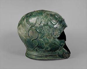 Two bronze helmets