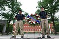 Two law enforcement explorers stand next to a wreath at the National Law Enforcement Officers Memorial.jpg