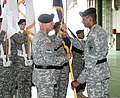 U.S. Army Gen. Vincent K. Brooks, right, the commanding general of U.S. Army Pacific passes the unit colors to Maj. Gen. James C. Boozer Sr., the incoming commander of U.S. Army Japan and I Corps (Forward) 130806-A-VH820-940.jpg