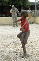 U.S. Army Maj. James Nelson, 71st Theater Information Operations Group, tosses a tape ball to a local Dominican boy near the site of a new U.S. military-built clinic at Vicente Noble, Dominican Republic 140621-A-UQ307-805.jpg