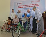U.S. Congressional delegation attends a wheelchairs and hearing aids distribution event in Danang (13941336552).jpg