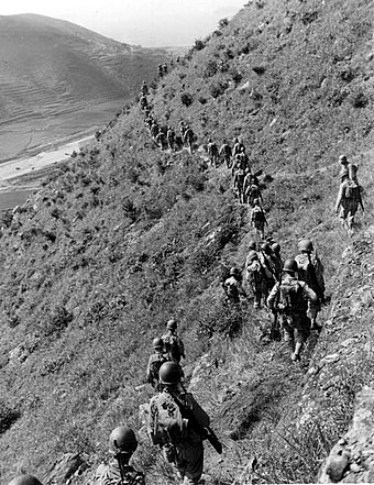 U.S. Marines move out over rugged mountain terrain while closing with North Korean forces. U.S. Marines in the Korean War 003.jpg