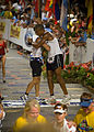 U.S. Navy Special Warfare Operator 1st Class (SEAL) David Goggins, right, assigned to Naval Special Warfare Center, embraces Cmdr. Keith Davids, commanding officer of SEAL Team One, as they cross the finish line 081011-N-BV344-004.jpg