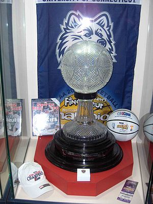 Connecticut Huskies women's basketball - 2004 Championship trophy, ring, and signed ball