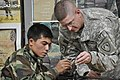 US Army 52829 KANDAHAR AIRFIELD, Afghanistan - Capt. Jeff Whitten, the 286th Combat SupportSustainment Battalion headquarters and headquarters company commander, shows an Afghan National Army soldier how to reassem.jpg