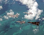 US Navy 021023-F-2034C-020 An Air Force F-15 'Eagle' and F-16 'Falcon' fly in formation with a Navy F-14 'Tomcat' and F-A-18 'Hornet' over the Atlantic Ocean during exercise Cope S.jpg