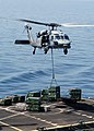 US Navy 030408-N-9228K-018 An MH-60S Knight Hawk delivers a crate of ordnance to the Military Sea Lift Command, ammunitions ship USNS Kiska (T-AE 35) during a weapons transfer from the USS Abraham Lincoln (CVN 72).jpg
