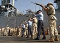 US Navy 030526-N-2819P-041 A U.S. Navy-Marine Corps firing detail provides a 21-gun salute on the flight deck aboard USS Kearsarge.jpg