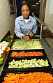 US Navy 031119-N-4768W-008 Mess Management Specialist 1st Class Pearlie Lewis, from Santa Clara, Calif., adds a creative touch to the salad bar in the wardroom aboard USS John C. Stennis (CVN 74).jpg