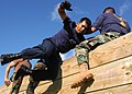 US Navy 040820-N-3019M-001 - A chief petty officer (CPO) selectee scales a wall with the help of his teammates at the Fleet Marine Force (FMF) Challenge.jpg