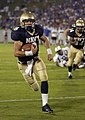 US Navy 040904-N-9693M-007 U.S. Naval Academy Midshipman 1st Class Aaron Polanco runs for a touchdown against the Duke Blue Devils to help Navy beat Duke 27-12 in the season opener for both teams.jpg