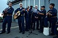 US Navy 041224-N-4757S-169 Sailors sing Christmas Carols on the flight deck of the guided missile cruiser USS Monterey (CG 61) on Christmas Eve.jpg