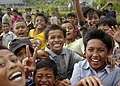 US Navy 050105-N-5376G-019 Indonesian children smile and cheer as U.S. Navy helicopters from USS Abraham Lincoln (CVN 72) fly-in purified water and relief supplies to a small village on the Island of Sumatra, Indonesia.jpg