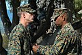 """US Navy 050209-N-0000X-001 U.S. Navy Hospital Corpsman 3rd Class Andrew R. Slaughter receives the Bronze Star medal with """"V"""" for valor and a Purple Heart medal at a ceremony held on board Camp Pendleton, Calif.jpg"""