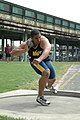 US Navy 050429-N-7975R-001 Midshipman 4th Class Darryl Hunter side steps into position for his first attempt in the shot put event at the Penn Relays.jpg