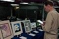 US Navy 050622-N-5800K-043 USS Ronald Reagan (CVN 76) Commanding Officer, Capt. James A. Symonds, judges entrants in the ship's first Metropolitan Art Center Juried Art Show and Exhibition.jpg