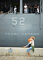 US Navy 050716-N-0050T-034 A mother and child say goodbye to their loved one aboard the dock landing ship USS Pearl Harbor (LSD 52).jpg