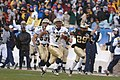 US Navy 051203-N-9693M-276 Navy slot back Reggie Campbell from Sanford, Fla., runs for a touch down during 2nd quarter play.jpg