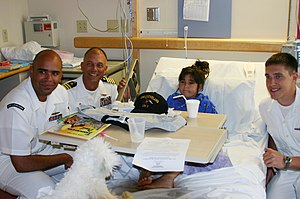 Rainbow Babies & Children's Hospital - Image: US Navy 060831 N 7163S 001 From left, Information Systems Technician 1st Class Tyrel Maynor, USS Cleveland (LPD 7) Commanding Officer Capt. Frank Mc Culloch, and Culinary Specialist Seaman Sean Unterdorfer visit a patient at Cle