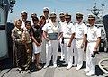 US Navy 070531-N-3970R-076 Dock landing ship USS Comstock (LSD 45) Commanding Officer, Cmdr. Burt L. Espe and his family receive an outstanding achievement award by retired Cmdr. Gil Gonzales, president of the Filipino American.jpg