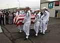 US Navy 070719-N-1755G-001 An honor guard detail attached to Navy Operational Support Center Indianapolis carries the casket of Fireman 3rd Class Alfred Eugene Livingston to a hearse.jpg
