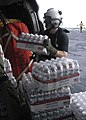 US Navy 070907-N-1189B-028 An aircrew Sailor on board multi-purpose amphibious assault ship USS Wasp (LHD 1), loads bottled water onto an MH-60S Seahawk assigned to Helicopter Sea Combat Squadron (HSC) 28.jpg
