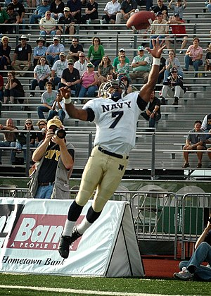 2007 Navy vs. North Texas football game - Image: US Navy 071110 N 8053S 106 Navy Midshipmen running back, Reggie Campbell, reaches for a pass during the during the Navy vs. University of North Texas (UNT) football game