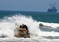 US Navy 080630-N-1424C-011 A Beach Master Unit (BMU) 1 Lighter Amphibious Re-supply Cargo (LARC) crashes through the surf.jpg