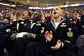 US Navy 081113-N-5758H-542 GS1 Donald Hammack, right, EN1 Donovan Williams and GSEC Raymond Quezada, all assigned to USS Freedom (LCS 1), cheer after the Cleveland Cavaliers score a point during a basketball game against the De.jpg