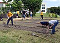 US Navy 090429-N-4124C-001 Members of the Norfolk, Va.-based USS Forrest Sherman (DDG 98) and the Portsmouth, N.H-based U.S. Coast Guard Cutter Tahoma (WMEC 908) build out a garden area that provides life skills training to men.jpg