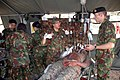 US Navy 090806-N-8539M-233 Royal Brunei Land Force medical personnel provide emergency medical treatment to U.S. Marines simulating mudslide victims during a humanitarian and disaster relief training scenario.jpg