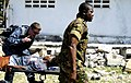 US Navy 100129-N-7948C-087 Logistics Specialist 3rd Class Jerdone McGhee, left, from Austin, Texas, speaks with a Haitian woman who is being medically evacuated.jpg