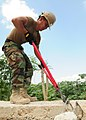 US Navy 100216-N-9643W-109 A Seabee assigned to Amphibious Construction Battalion (ACB) 2 cuts rebar on a damaged wall near Toussaint Louverture International Airport in Port-au-Prince, Haiti.jpg