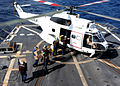 US Navy 100219-N-7088A-029 Sailors aboard USS Farragut (DDG 99) load mail onto a helicopter.jpg