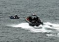 US Navy 100331-N-7058E-516 A response team of Sailors and U.S. Coast Guardsmen from the littoral combat ship USS Freedom (LCS 1) prepares to apprehend a.jpg