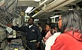 US Navy 100427-N-5812W-001 Chief Gas Turbine System Technician (Mechanical) Gregory Reynolds explains the propulsion control console to members of the Women of Tomorrow Mentor and Scholarship Program.jpg