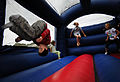 US Navy 100511-N-6046S-084 Children play on a moon bounce during the monthly We Care Supper.jpg
