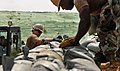 US Navy 100824-N-7280V-362 Equipment Operator 2nd Class Christopher Dain arranges sand bags during a training exercise.jpg