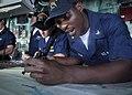 US Navy 100831-N-3620B-068 Quartermaster 3rd Class Frederick D. Morgan plots a course from the pilothouse aboard USS Denver (LPD 9) as the ship departs Fleet Activities Yokosuka.jpg
