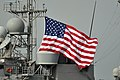 US Navy 110216-N-7293M-462 The holiday flag is raised aboard the guided-missile cruiser USS Leyte Gulf (CG 55) as the ship participates in a combin.jpg