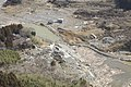 US Navy 110318-M-HU778-010 An aerial view of Minato, Japan, a week after a 9.0 magnitude earthquake and subsequent tsunami devastated the area.jpg