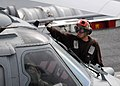 US Navy 110926-N-HI414-240 A Sailor cleans the windshield of an MH-60S Sea Hawk helicopter aboard USS Abraham Lincoln (CVN 72).jpg