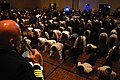 US Navy 111112-N-HP195-013 Veterans and current service members in dinner dress uniforms do push ups on the dance floor during the 16th annual Mili.jpg