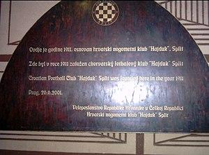 U Fleků - The plaque commemorating the founding of Croatian football club Hajduk at the pub in 1911.